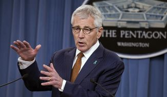 FILE - In this Dec. 4, 2014 file photo, Defense Secretary Chuck Hagel speaks at the Pentagon. The Pentagon took initial steps Friday to set up a new agency that will direct the troubled effort to search for America's missing war dead, two years after an internal report found the current program was mismanaged and wasteful.  (AP Photo/Cliff Owen, File)