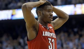 Louisville's Chinanu Onuaku (32) reacts following Louisville's 72-71 loss to North Carolina following an NCAA college basketball game in Chapel Hill, N.C., Saturday, Jan. 10, 2015. (AP Photo/Gerry Broome)