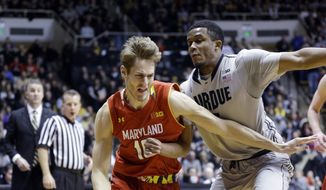 Maryland forward Jake Layman (10) drives under Purdue forward Basil Smotherman (5) in the first half of an NCAA college basketball game in West Lafayette, Ind., Saturday, Jan. 10, 2015. (AP Photo/Michael Conroy)