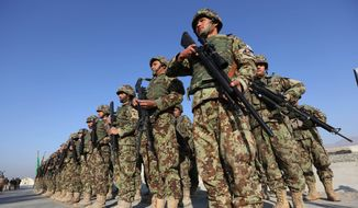 Afghan security forces attend a ceremony in Laghman province, east of Kabul, Afghanistan, in this Sunday, Jan. 11, 2015, file photo. (AP Photo/Rahmat Gul) ** FILE **