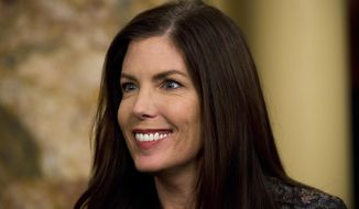 Pennsylvania Attorney General Kathleen Kane looks on before newly elected members of the Pennsylvania Legislature are sworn in, Tuesday, Jan. 6, 2015, at the state Capitol in Harrisburg, Pa. Republicans who control both the Senate and House picked up additional seats in the November election. In the House, Republicans outnumber Democrats 119 to 84 and in the Senate, 30 to 20. (AP Photo/Matt Rourke)