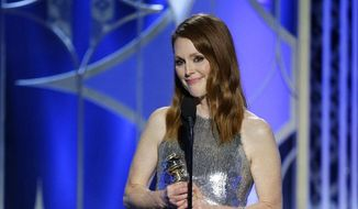 """In this image released by NBC, Julianne Moore accepts the award for best actress in a drama film for her role in """"Still Alice"""" at the 72nd Annual Golden Globe Awards on Sunday, Jan. 11, 2015, at the Beverly Hilton Hotel in Beverly Hills, Calif. (AP Photo/NBC, Paul Drinkwater)"""