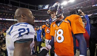 Denver Broncos quarterback Peyton Manning (18) greets Indianapolis Colts cornerback Vontae Davis (21) after an NFL divisional playoff football game, Sunday, Jan. 11, 2015, in Denver. The Colts won 24-13 to advance to the AFC Championship game against the New England Patriots. (AP Photo/Jack Dempsey)