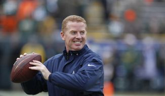 Dallas Cowboys head coach Jason Garrett warms up players before an NFL divisional playoff football game against the Green Bay Packers Sunday, Jan. 11, 2015, in Green Bay, Wis. (AP Photo/Matt Ludtke)