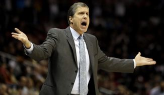 Washington Wizards head coach Randy Wittman calls to an official during the second quarter of an NBA basketball game against the Atlanta Hawks, Sunday, Jan. 11, 2015, in Atlanta. The Hawks won 120-89. (AP Photo/David Goldman)
