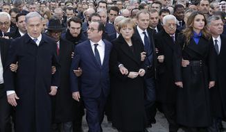 From the left : Israel's Prime Minister Benjamin Netanyahu, Mali's President Ibrahim Boubacar Keita, France's President, Germany's Chancellor Angela Merkel, EU President Donald Tusk, Palestinian President Mahmoud Abbas, King Abdullah of Jordan and Queen Rania Al Abdullah march during a rally in Paris, France, Sunday, Jan. 11, 2015. A rally of defiance and sorrow, protected by an unparalleled level of security, on Sunday will honor the 17 victims of three days of bloodshed in Paris that left France on alert for more violence. (AP Photo/Philippe Wojazer, Pool)