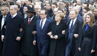 From left, Israeli Prime Minister Benjamin Netanyahu, Malian President Ibrahim Boubacar Keita, French President Francois Hollande, German Chancellor Angela Merkel, EU president Donald Tusk, Queen Rania of Jordan march in Paris, France, Sunday, Jan. 11, 2015. Thousands of people began filling France's iconic Republique plaza, and world leaders converged on Paris in a rally of defiance and sorrow on Sunday to honor the 17 victims of three days of bloodshed that left France on alert for more violence. (AP Photo/Michel Euler)