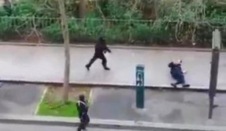 Paris residents captured chilling video images after an attack at a French satirical newspaper. French officials are dealing with challenges of an evolving terrorist group. (Associated Press)