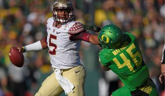 Would new general manager Scot McCloughan pass up the chance to draft Florida State quarterback Jameis Winston with the fifth pick in this year's NFL draft? If McCloughan really believes in taking the best player on the board and the former Heisman Trophy winner is still available, he should. (Associated Press Photographs)
