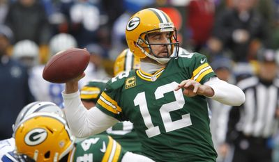 Green Bay Packers quarterback Aaron Rodgers (12) throws a pass during the first half of an NFL divisional playoff football game against the Dallas Cowboys Sunday, Jan. 11, 2015, in Green Bay, Wis. (AP Photo/Matt Ludtke)