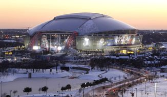 FILE - In this Feb 4, 2011 file photo, snow and ice surrounds the grounds around Cowboys Stadium as the sun sets in Arlington, Texas. Dog shows to championships, Jerry Jones believes the $1.2 billion showplace of the Dallas Cowboys will always be a destination for signature events. (AP Photo/Tony Gutierrez)