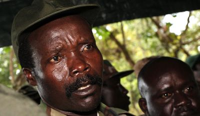In this Nov. 12, 2006, file photo, the leader of the Lord's Resistance Army, Joseph Kony answers journalists' questions following a meeting with U.N. humanitarian chief Jan Egeland at Ri-Kwangba in southern Sudan. (AP Photo/Stuart Price, File, Pool)