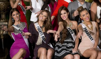Miss Universe contestants, from left, Desire Cordero, of Spain, Gabriela Berrios, of Puerto Rico, Jimena Vecco, of Peru, and Sally Jara Davalos, of Paraguay, pose for photos during a news conference for contestants from Latin America and Spain, Monday, Jan. 12, 2015 in Doral, Fla. The Miss Universe pageant will be held on Jan. 25, in Miami. (AP Photo/Wilfredo Lee)