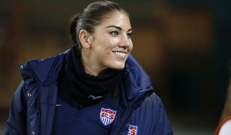 """FILE - In this Oct. 20, 2014, file photo, U.S. goalkeeper Hope Solo stands on the sidelines before a CONCACAF soccer match against Haiti in Washington. Solo had domestic violence assault charges against her dismissed Tuesday, Jan. 13, 2015, ending what she called """"one of the most difficult and emotionally draining times of my life."""" (AP Photo/Alex Brandon, File)"""
