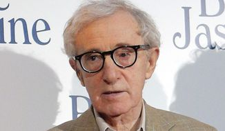 """This Aug. 27, 2013, file photo shows director and actor Woody Allen at the French premiere of """"Blue Jasmine,"""" in Paris. (AP Photo/Christophe Ena, File)"""