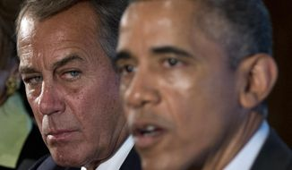 House Speaker John Boehner of Ohio listens at left as President Barack Obama speaks to media during a meeting with bipartisan, bicameral leadership of Congress to discuss a wide range of issues, Tuesday, Jan. 13, 2015, in the Cabinet Room of the White House in Washington. (AP Photo/Carolyn Kaster)