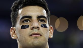 Oregon's Marcus Mariota during the national anthem before the NCAA college football playoff championship game against Ohio State Monday, Jan. 12, 2015, in Arlington, Texas. (AP Photo/David J. Phillip)