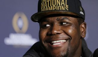 Ohio State's Cardale Jones reacts to a question during a news conference after the NCAA college football playoff championship game Tuesday, Jan. 13, 2015, in Dallas. Ohio State defeated Oregon 42-20 on Monday. Jones was names the offensive player of the game. (AP Photo/David J. Phillip)