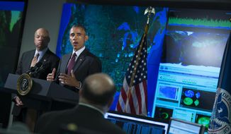 Homeland Security Secretary Jeh Johnson listens at left as President Barack Obama speaks at the National Cybersecurity and Communications Integration Center in Arlington, Va., Tuesday, Jan. 13, 2015. Obama renewed his call for Congress to pass cybersecurity legislation, including a proposal that encourages companies to share threat information with the government and protects them from potential lawsuits if they do. (AP Photo/Evan Vucci)