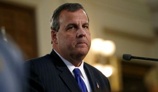 New Jersey Gov. Chris Christie delivers his State Of The State address, Tuesday, Jan. 13, 2015, in Trenton, N.J. (AP Photo/Julio Cortez)