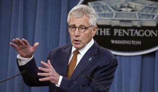 Defense Secretary Chuck Hagel speaks at the Pentagon in this Dec. 4, 2014, file photo. (AP Photo/Cliff Owen, File)