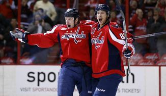 Washington Capitals left wing Jason Chimera, left, and center Jay Beagle celebrate Chimera's goal in the first period of an NHL hockey game against the Philadelphia Flyers, Wednesday, Jan. 14, 2015, in Washington. (AP Photo/Alex Brandon)