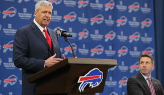Rex Ryan addresses the media at an NFL football news conference after he was introduced as the new head coach of the Buffalo Bills, Wednesday, Jan. 14, 2015, in Orchard Park, N.Y. Team president Russ Brandon listens at right .(AP Photo/Bill Wippert)