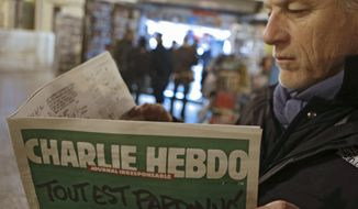 "Jean Paul Bierlein reads the latest issue of Charlie Hebdo outside a newsstand in Nice, southeastern France, Wednesday, Jan. 14, 2015. In an emotional act of defiance, Charlie Hebdo resurrected its irreverent and often provocative newspaper, featuring a caricature of the Prophet Muhammad on the cover that drew immediate criticism and threats of more violence. The black letters on the front page read: ""All is forgiven."" (AP Photo/Lionel Cironneau) **FILE**"