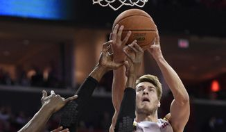 Rutgers guard/forward Malick Kone (0) battles for the ball against Maryland guard/forward Jake Layman (10) during the first half of an NCAA college basketball game, Wednesday, Jan. 14, 2015, in College Park, Md. (AP Photo/Nick Wass)