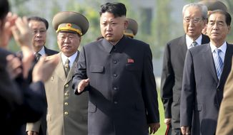 In this July 25, 2013, file photo, North Korean leader Kim Jong-un, center, arrives at the cemeteries of fallen fighters of the Korean People's Army (KPA) in Pyongyang, North Korea. (AP Photo/Wong Maye-E, File)