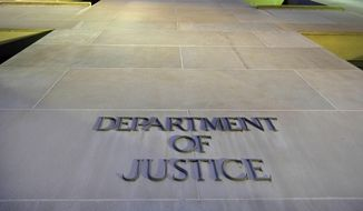 FILE - In this May 14, 2013 file photo, the Department of Justice headquarters building is seen in Washington. The Justice Department has issued new guidelines for obtaining records from the news media during leak investigations. The procedures, a revision of policies announced last year, are designed to give news organizations a chance to challenge subpoenas or search warrants in court.  (AP Photo/J. David Ake, File)