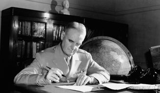 General William Donovan works in the OSS headquarters offices during World War II. (OSS Society)