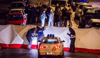 Police investigate a shootout in a street in Verviers, Belgium, Thursday, Jan. 15, 2015. Belgian authorities say two people have been killed and one has been arrested during a shootout in an anti-terrorist operation in the eastern city of Verviers. (AP Photo / Geert Vanden Wijngaert)