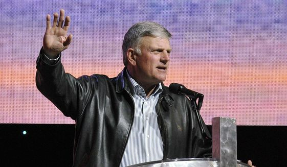 Christian evangelist Franklin Graham speaks in Erie, Pa., as part of a two-day music and evangelism festival in this Sept. 27, 2014, file photo. (AP Photo/Erie Times-News, Greg Wohlford) ** FILE **