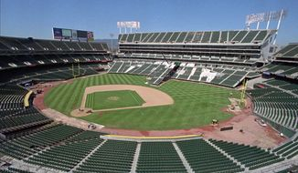 FILE -- This Aug. 7, 1996, file photo, shows the Oakland Coliseum in transition from baseball to football field configuration in Oakland, Calif. A federal appeals court upheld the dismissal of antitrust claims in a lawsuit by the city of San Jose against Major League Baseball, which accused the sport of illegally blocking a proposed move of the Oakland Athletics to the area, Thursday, Jan. 15, 2015.  (AP Photo/Ben Margot, File)