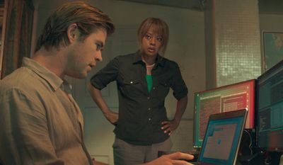 """Chris Hemsworth and Viola Davis star in Michael Mann's latest (but not his best) cool-guy movie, """"Blackhat,"""" a contemporary techno-thriller about dueling hackers. (Associated Press)"""