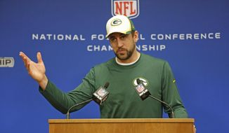 Green Bay Packers quarterback Aaron Rodgers speaks at an NFL football news conference Wednesday, Jan. 14, 2015, in Green Bay, Wis. (AP Photo/Matt Ludtke) ** FILE **