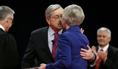 Iowa Gov. Terry Branstad kisses his wife Chris, right, after taking the oath of office during inauguration ceremonies, Friday, Jan. 16, 2015, in Des Moines, Iowa. (AP Photo/Charlie Neibergall)