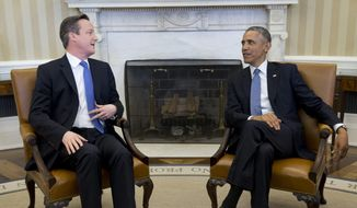President Barack Obama meets with British Prime Minister David Cameron, Friday, Jan. 16, 2015, in the Oval Office of the White House in Washington. Growing fears about the specter of terrorism in Europe and the West are lending themselves to a sense of trans-Atlantic solidarity as President Barack Obama and British Prime Minister David Cameron met at the White House. (AP Photo/Carolyn Kaster)