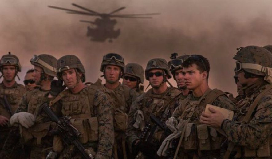 Marine Infantry Officer Course students await a CH-53E ...