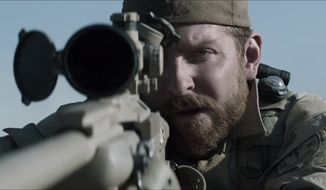 "Actor Bradley Cooper stars as Chris Kyle in the movie ""American Sniper."" (2014 Warner Bros. Entertainment Inc.)"