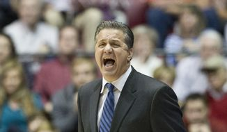Kentucky head coach John Calipari shouts directions at his team during the first half of an NCAA college basketball game against Alabama, Saturday, Jan. 17, 2015, in Tuscaloosa, Ala. Kentucky won 70-48. (AP Photo/Brynn Anderson)