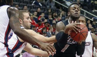 VCU's JeQuan Lewis (1) is defended by Duquesne's Micah Mason, left, during the second half of an NCAA college basketball game in Pittsburgh, Saturday, Jan. 17, 2015. VCU won 70-64. (AP Photo/Gene J. Puskar)