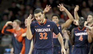 Virginia's London Perrantes (32) celebrates after hitting a 3-point shot during the second half of an NCAA college basketball game against Boston College, Saturday, Jan. 17, 2015, in Boston. Virginia won 66-51. (AP Photo/Mary Schwalm)