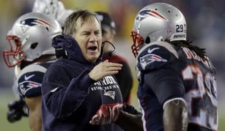 New England Patriots head coach Bill Belichick congratulates LeGarrette Blount after his touchdown during the second half of the NFL football AFC Championship game against the Indianapolis Colts Sunday, Jan. 18, 2015, in Foxborough, Mass. (AP Photo/Charles Krupa)