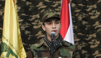 In this picture taken on Feb., 22, 2008, Jihad Mughniyeh, the son of slain top Hezbollah commander Imad Mughniyeh, speaks during a rally to commemorate his father and two other leaders Abbas Musawi and Ragheb Harb, in the Shiite suburb of Beirut, Lebanon. A Hezbollah official said Sunday, Jan. 18, 2015, that an Israeli strike in the Syrian Golan Heights killed Jihad Mughniyeh and four other fighters from the Lebanese Shiite militant group. (AP Photo/Hussein Malla)