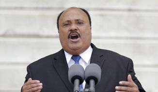 """My father's approach to the most brutal and unambiguous social injustices during the civil rights struggle was rooted in nonviolence as a morally and tactically correct response,"" Martin Luther King III said in an interview with The Washington Times. ""In no way do I, nor would my father, condone any 'ends justify the means' behavior."" (Associated Press)"
