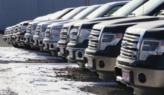 In this Jan. 13, 2015 photo, Ford F-150 pickup trucks are lined up at the Lee Sapp Ford dealership in Ashland, Neb. With cheaper gasoline in the tank, some car dealers find they have too many smaller fuel-efficient cars, when trucks and sports cars might sell better. Lee Sapp, who runs the Ford dealership in Ashland, Neb., says that fluctuating gas prices will not necessarily make a person who thinks he needs an F-150 or wants an F-150 pickup truck, switch to a compact car.  (AP Photo/Nati Harnik)