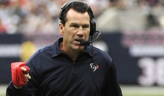 File-This Sept. 30, 2012, file photo shows Houston Texans coach Gary Kubiak waving a red flag to challenge a first down call in the first quarter of an NFL football game against the Tennessee Titans in Houston. Kubiak is John Elway's No. 2 again. The Denver Broncos general manager and executive vice president was hashing out a four-year contract with his former backup QB, Kubiak,  to become the team's head coach, a person with knowledge of the negotiations told The Associated Press on Sunday, Jan. 18, 2015. (AP Photo/Dave Einsel, File)