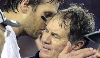 New England Patriots quarterback Tom Brady, left, speaks with Bill Belichick after the NFL football AFC Championship game Sunday, Jan. 18, 2015, in Foxborough, Mass. The Patriots defeated the Colts 45-7 to advance to the Super Bowl against the Seattle Seahawks. (AP Photo/Charles Krupa)